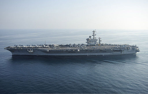 The aircraft carrier USS Nimitz (CVN 68) travels in the Persian Gulf Aug. 13, 2013 130813-N-IB033-166