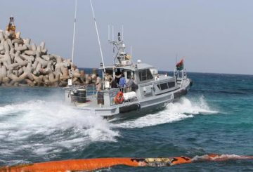 Members of Libya's naval coastguard man a speed boat as they wait for the arrival of the Morning Glory, an oil tanker that US Navy handed over to Libyan authorities at Zawiya port in Zawiya, Libya, 22 March 2014. ANSA/SABRI ELMHEDWI