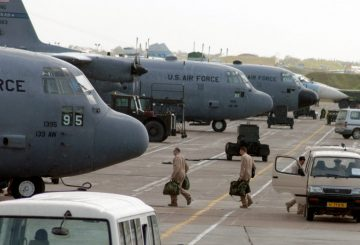 C-130 Hercules aircrew members board their aircraft for an Operation Enduring Freedom mission at Karshi-Khanabad Air Base, Uzbekistan, on April 19, 2005. (U.S. Air Force Photo/Master Sgt. Scott T. Sturkol)